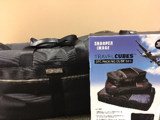 Tommy Hilfiger Duffle and Sharper Image Travel Cubes