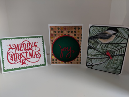 Assortment of hand crafted cards, gift tags, and holiday cards