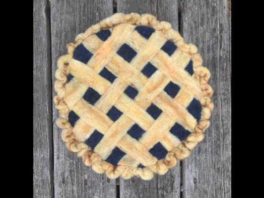 Maine blueberry pie fiber art by Mia Waisman