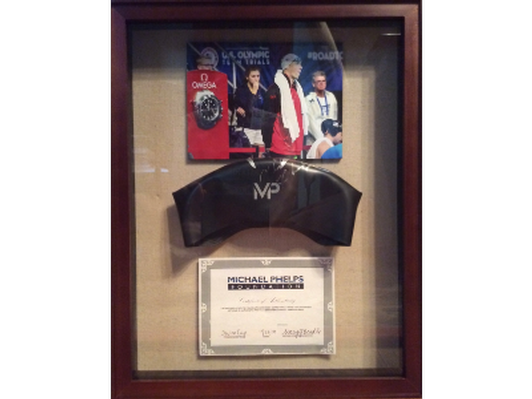 Framed Swim Cap Autographed by Michael Phelps with Authentication Certificate