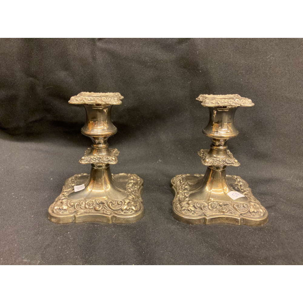 Set of 2 short silver coloured candle sticks