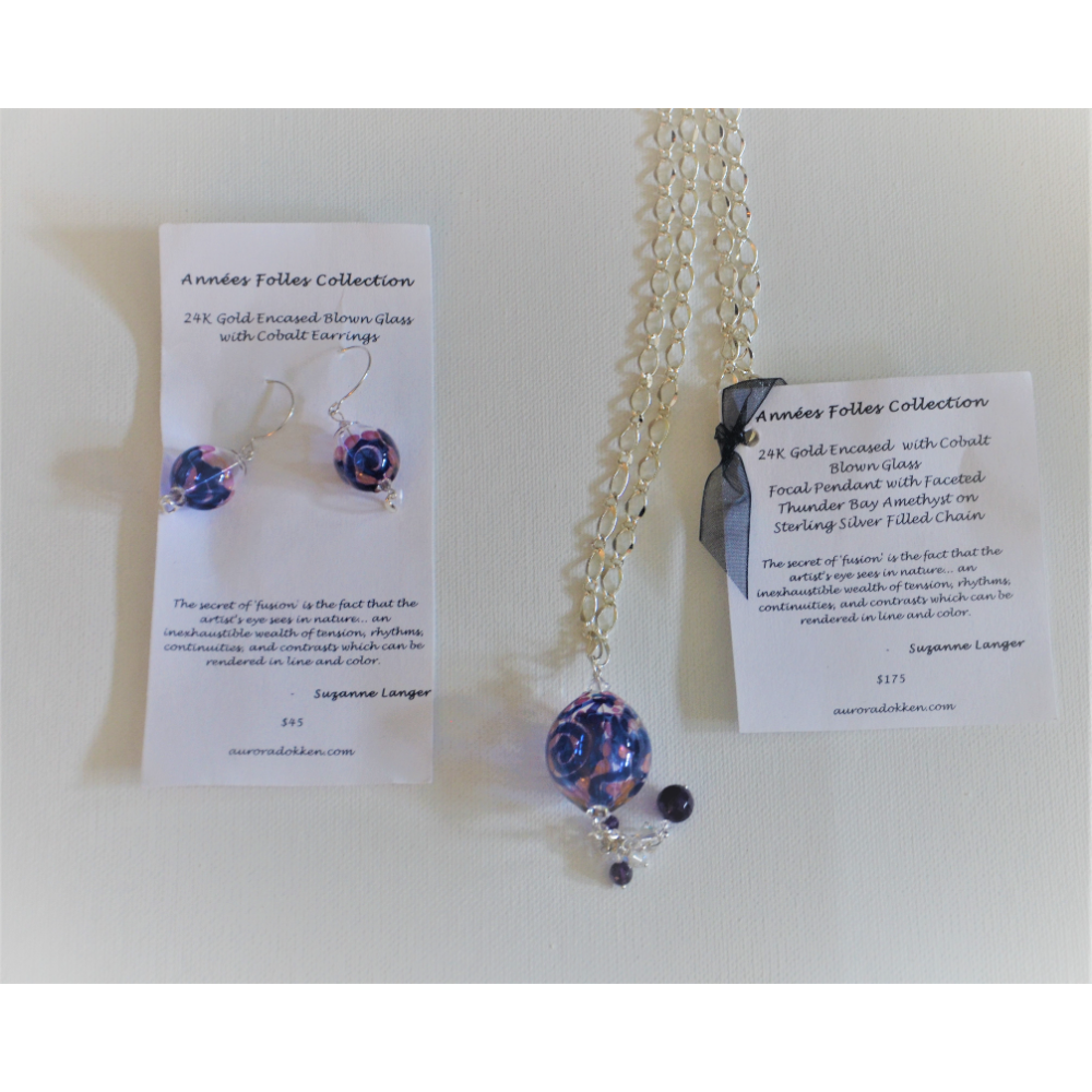 Blown glass pendant and earrings donated by Aurora Dokken of Exp Realty