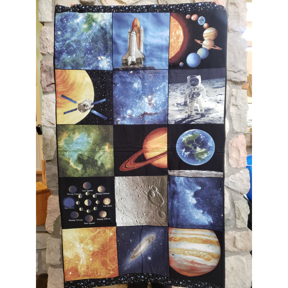 """Space: The New Frontier"" crib quilt"