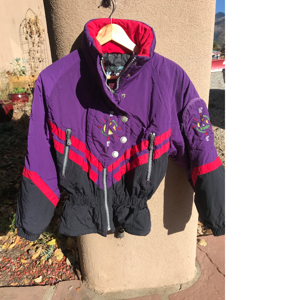 Purple ski jacket and ski pants