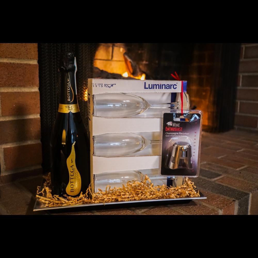 Bottle of Bottega Prosecco, Six Luminarc Champagne Glasses and a Champagne Recorker