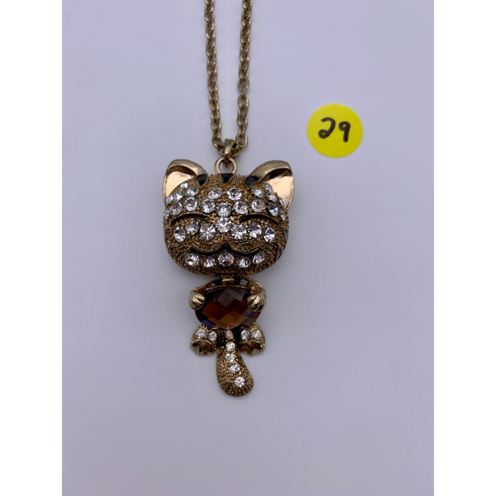 A whimsicle Gold Tiger pendent bejeweled with white gemstones