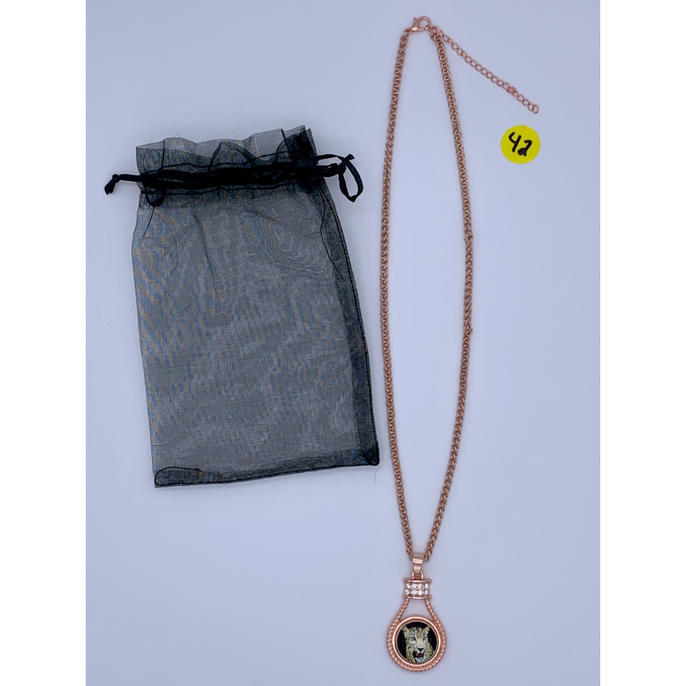 """Costume Jewelry- Rosegold plated pendent on a 9 & 1/2"""" chain with a Cheetah Portrait in the center."""
