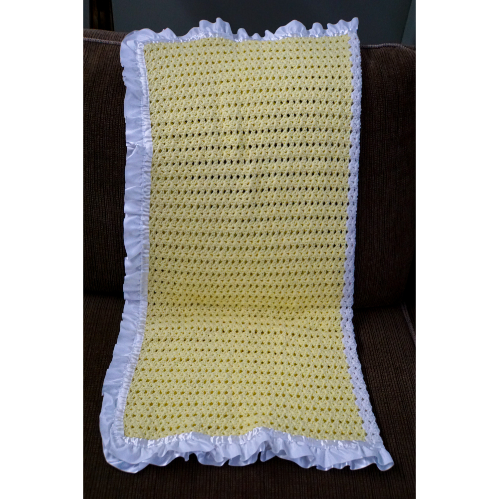 Handknit baby blanket with doll