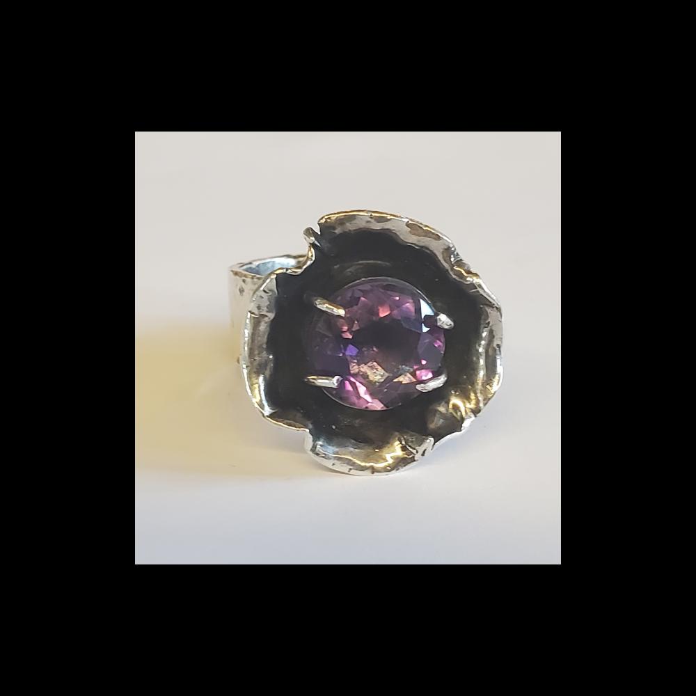 This is a handmade, diamond-cut amethyst with Italian cut silver.